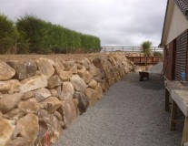 Rock retaining wall