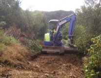 Small digger making bush track