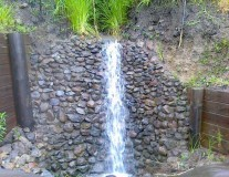 Rock waterfall feature